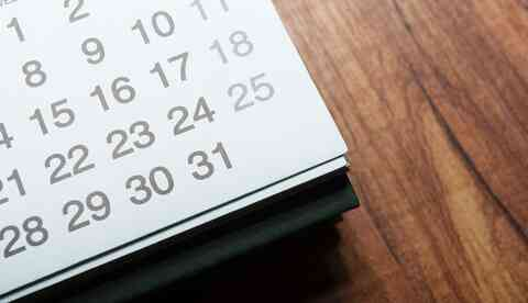 Artistic picture of a calendar lying on a table