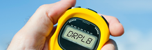 Hand holding stopwatch that says DRPL8